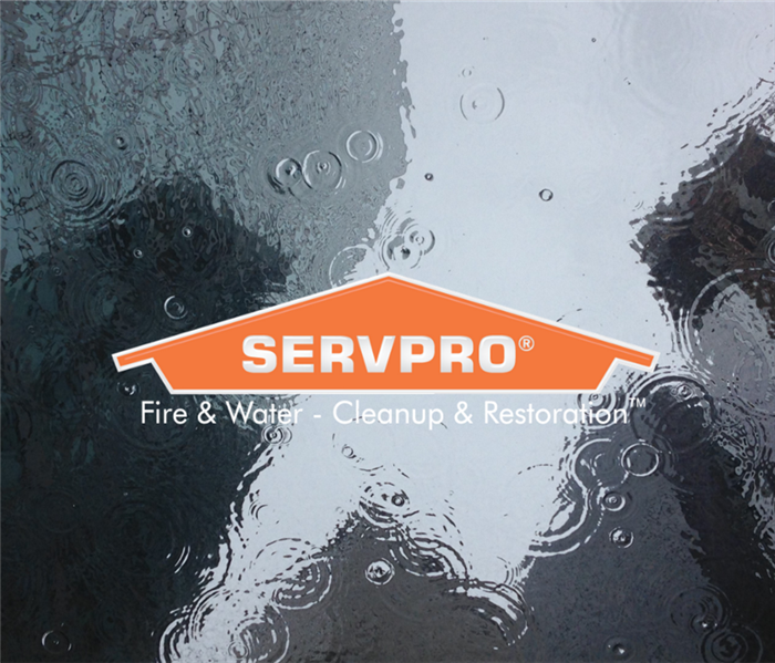 SERVPRO logo with puddle of water in background