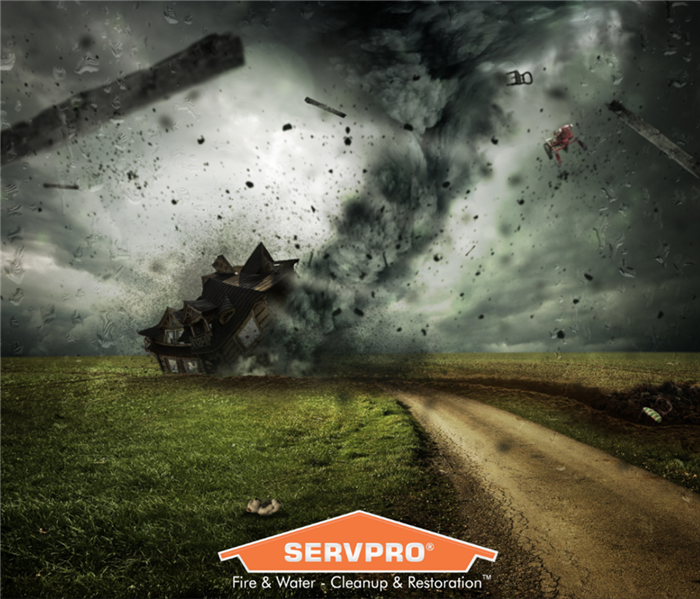 SERVPRO logo with tornado hitting home in background