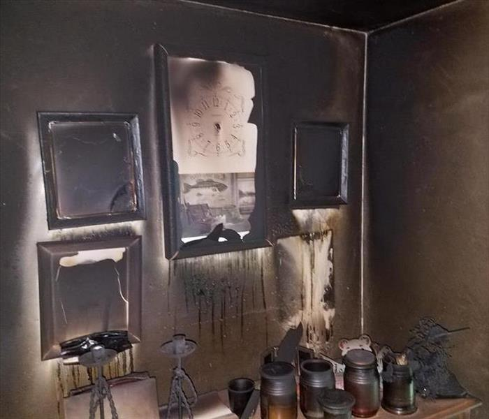 Soot covered walls and pictures