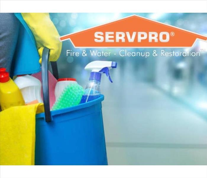 SERVPRO logo with person holding a bucket of cleaning supplies.
