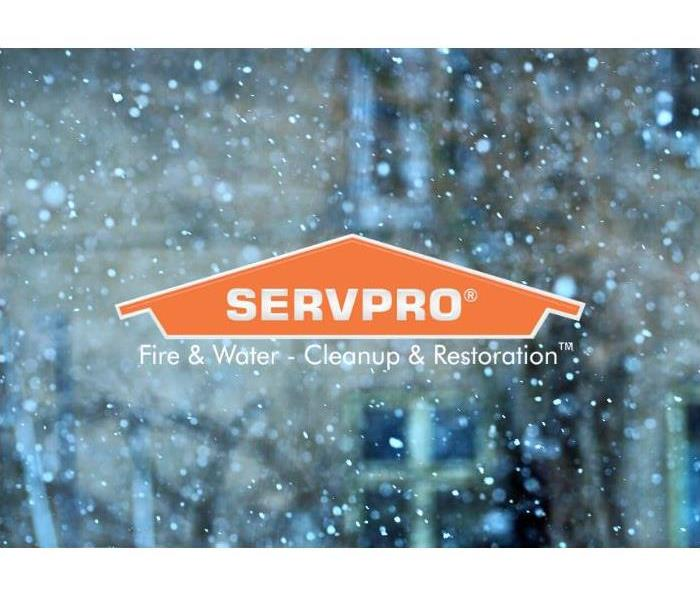 SERVPRO logo with snow in background.