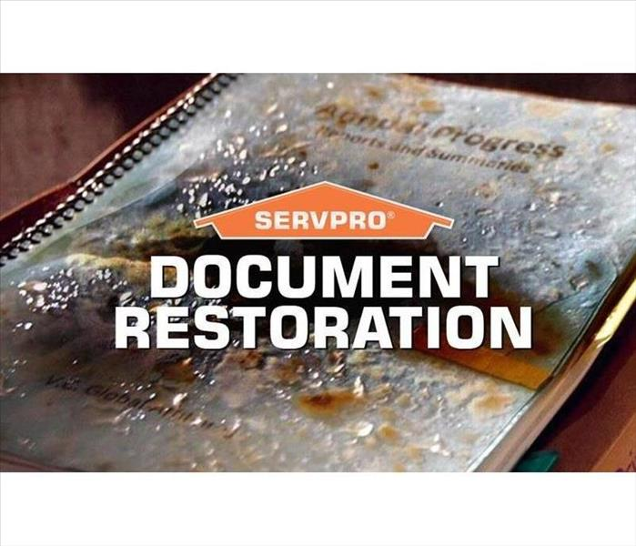 SERVPRO and document restoration logo on water damaged document.